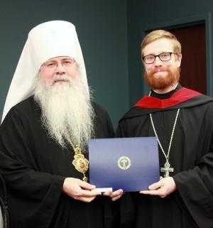 Valedictorian Fr. William Rettig is awarded his diploma by Metropolitan Tikhon