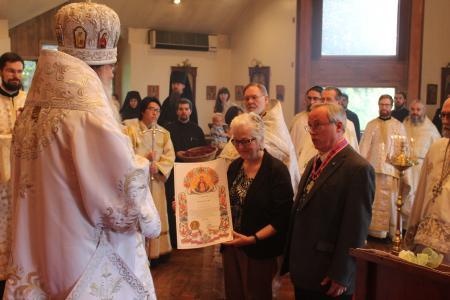 Receiving the Silver St. Innocent Award from Metropolitan Tikhon (Photo: Alexandru Popovici)