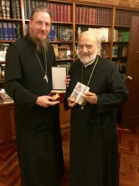 Fr. John Behr exchanging gifts with Abp. Stylianos, primate of the Greek Orthodox Church in Australia, and dean and founder of St. Andrew's Greek Orthodox Theological College, Sydney (photo: Philip Kariatlis)