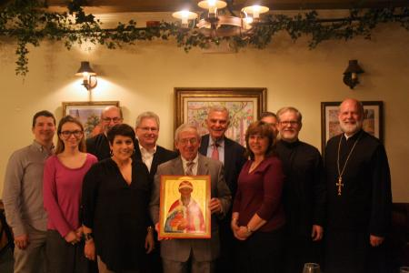 The Board of Trustees honoring Anthony Kasmer (center, with icon) for his 12 years of service as a board member (photo: Alexandru Popovici)