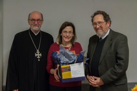 Dr. Will Jacobs (far right), winning the SVS Press book drawing at the concert reception, with Archpriest Chad Hatfield, CEO, and Sharon Macrina Ross, Director of Institutional Advancement at SVOTS