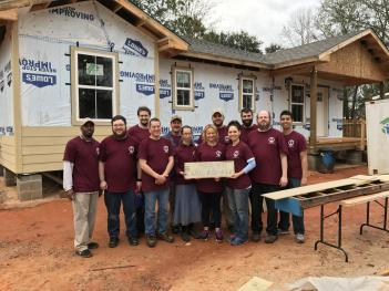 Seminarians Antwian Davis and Evan LeDoux (far left and second from left), and Dn. Andrew Honoré (far right), with the rest of the crew at the IOCC and Habitat for Humanity build in New Orleans