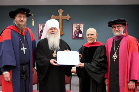 (from left) Dean Archpriest John Behr, Metropolitan Tikhon, Guest Lecturer Dr. Lewis Patsavos, and President Archpriest Chad Hatfield, during the awarding of the honorary doctorate at the 34th Annual Schmemann Lecture (photo: Mary Honoré)