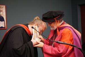 Dn. Joseph Wesseler presents the St. Macrina Award to Fr. Chad Hatfield (photo: Adrienne Soper)