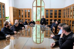 Archpriest Chad Hatfield meeting ​with professors of the ​ Faculty of Orthodox Theology​ in ​ Bucharest
