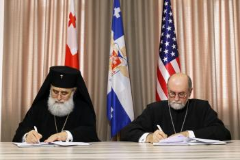 His Eminence, Metropolitan Grigoli of Poti & Khobi (left) signs the partnership agreement with St. Vladimir's Seminary with Archpriest Chad Hatfield.