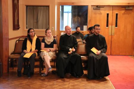 Shelby Giokas (second from left) and fellow seminarians listening to a talk at the Seminary's Three Hierarchs Chapel